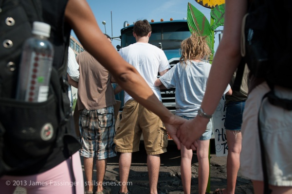 Supporters and members of Detroit Coalition Against Tar Sands (DCATS) block a truck hauling petroleum coke to the controversial storage facility and docks along the Detroit River Monday June 24, 2013.
